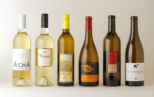 6 bottles of Grenache Blanc & Albarino as seen in San Francisco, California, Wednesday, June 27, 2012.  Left-right:  2010 Acha Blanca Albarino,  2011 Longoria Albarino,  2011 Abacela Albarino,  2011 Mother Ship Grenache Blanc,  2011 Kinero Alice Grenache Blanc,  2011 Two Shepherds Grenache Blanc Photo: Craig Lee, Special To The Chronicle