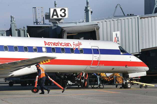 A worker prepares the  final flight of American Eagle Airlines on the tarmac  as it makes it very last appearance at the Albany International Airport, Saturday, November 1, 2008. (Times Union archive) Photo: STEVE JACOBS, TIMES UNION / 00000834A