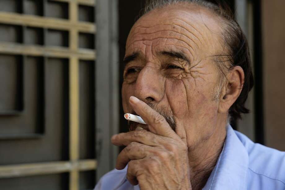 A senior citizen smokes a cigarette at Revolution Square on May 31, 2012 in Mexico City during the World No Tobacco Day.  At least sixty thousand Mexicans die each year from diseases associated with smoking, experts said.  AFP PHOTO/Yuri CORTEZYURI CORTEZ/AFP/GettyImages Photo: Yuri Cortez, AFP/Getty Images