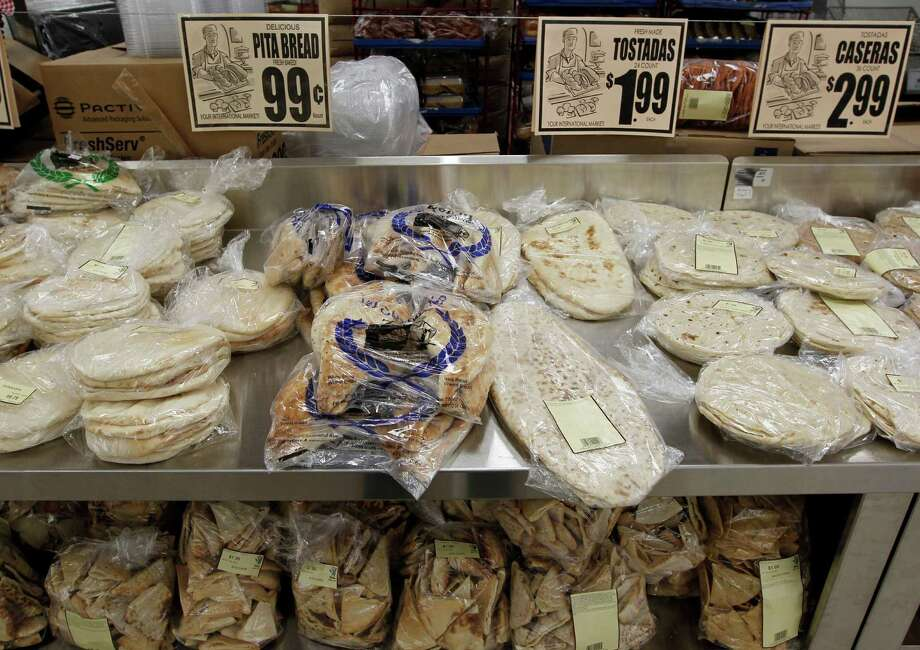 A selection of flat breads at the new Fiesta grocery store at Westheimer and Dairy Ashford Monday, June 25, 2012, in Houston. Photo: James Nielsen, Chronicle / © Houston Chronicle 2012
