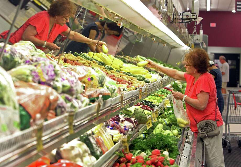Judith Donaldson shops for produce at the new Fiesta grocery store at Westheimer and Dairy Ashford Monday, June 25, 2012, in Houston. Photo: James Nielsen, Chronicle / © Houston Chronicle 2012