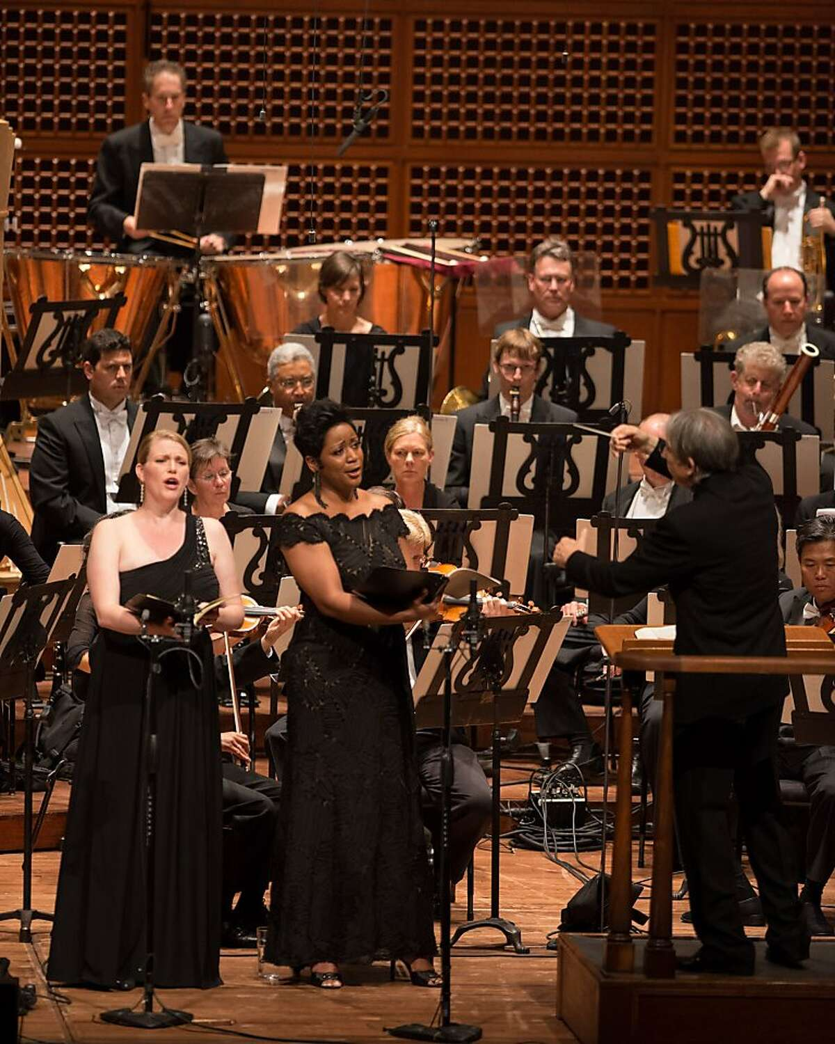 Music Director Michael Tilson Thomas conducts the San Francisco Symphony and Chorus and guest soloists soprano Erin Wall (l.), and mezzo-soprano Kendall Gladen, in Beethoven's Symphony No. 9 at Davies Symphony Hall June 27-30, 2012.