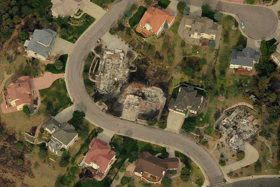 This aerial photo shows the destructive path of the Waldo Canyon fire in the Mountain Shadows subdivision area of Colorado Springs, Colo., Thursday, June 28, 2012. Colorado Springs officials  said Thursday that hundreds of homes have been destroyed by the raging wildfire. Photo: Denver Post, RJ Sangosti