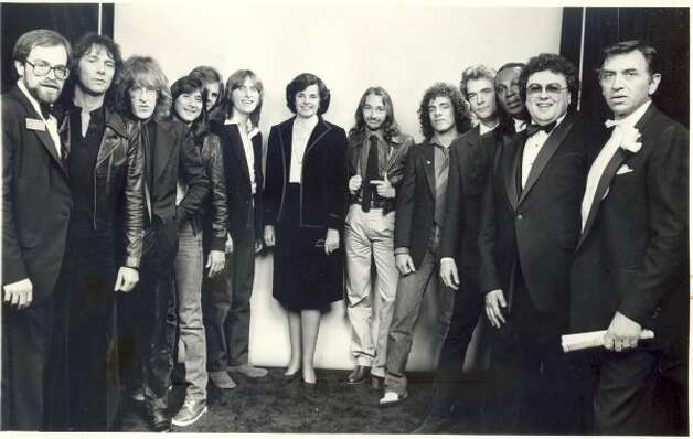 OH I WANT TO BE THERE, IN MY CITY: Journey with Jefferson Starship, Bill Graham, Huey Lewis and Dianne Feinstein. One can only assume they were signing a city contract that guaranteed future National Anthem rights until the year 2024. (Chronicle File / 1984)