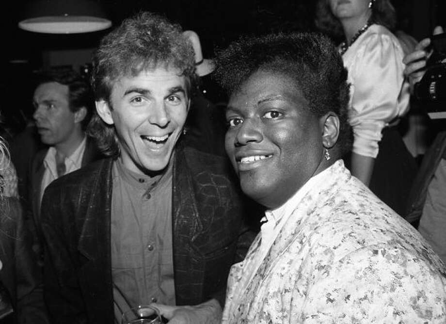"""BURNING LIKE WILDFIRE: """"You were sounding a little pitchy there, Jonathan Cain."""" In case you thought it was an urban legend that Randy Jackson was a member of Journey, here's the amazingly-coiffed proof. I also have one of him with Bill Graham. (Alex Clausen)"""