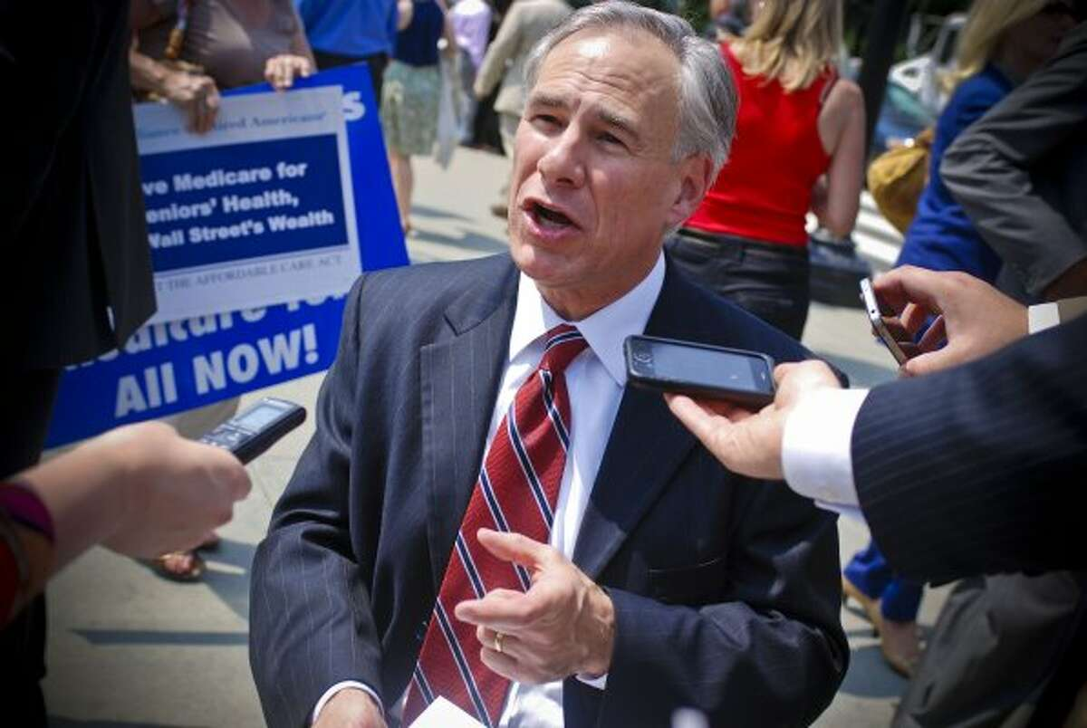 Texas Attorney General Greg Abbott spoke with members of the media following the justices' ruling, stating his belief that the battle over healthcare legislation was 'far from over.' (Francis Rivera / The Houston Chronicle )