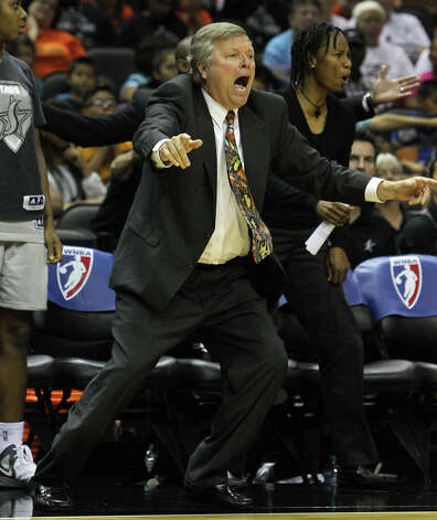 Silver Stars head coach and general manager Dan Hughes reacts after a play against the Los Angeles Sparks in the second half at the AT&T Center on Thursday, June 28, 2012. Silver Stars defeated the Sparks, 94-80. Photo: Kin Man Hui, Kin Man Hui/Express-News / ©2012 San Antonio Express-News