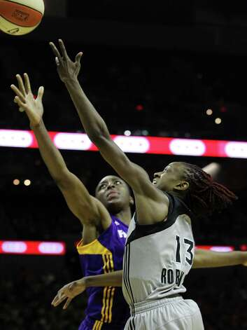Silver Stars' Danielle Robinson (13) puts up a shot against the Los Angeles Sparks' Nneka Ogwumike (30) in the second half at the AT&T Center on Thursday, June 28, 2012. Silver Stars defeated the Sparks, 94-80. Photo: Kin Man Hui, Kin Man Hui/Express-News / ©2012 San Antonio Express-News