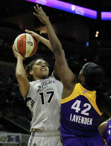 Silver Stars' Ziomara Morrison (17) takes a shot against the Los Angeles Sparks' Jantel Lavender (42) in the first half at the AT&T Center on Thursday, June 28, 2012. Photo: Kin Man Hui, Kin Man Hui/Express-News / ©2012 San Antonio Express-News