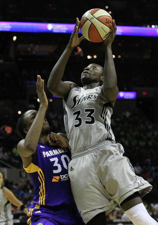 Silver Stars' Sophia Young (33) drives to the basket against the Los Angeles Sparks' Nneka Ogwumike (30) in the second half at the AT&T Center on Thursday, June 28, 2012. Silver Stars defeated the Sparks, 94-80. Photo: Kin Man Hui, Kin Man Hui/Express-News / ©2012 San Antonio Express-News