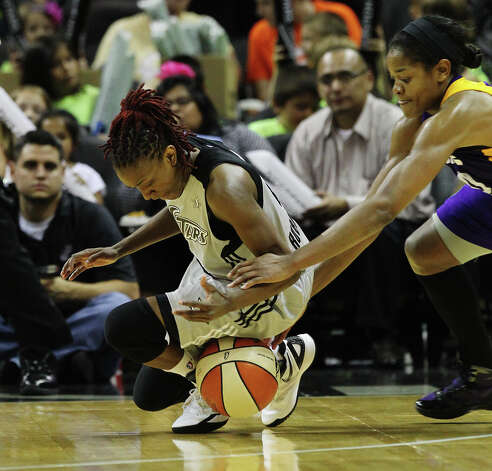 Silver Stars' Danielle Robinson (13) scrambles for a loose ball against the Los Angeles Sparks' Alana Beard (0) in the second half at the AT&T Center on Thursday, June 28, 2012. Silver Stars defeated the Sparks, 94-80. Photo: Kin Man Hui, Kin Man Hui/Express-News / ©2012 San Antonio Express-News