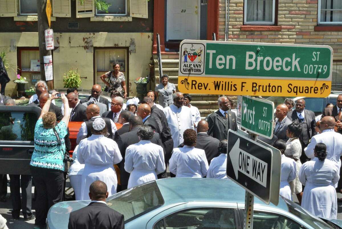 Mourners lift the casket into a hearse at Rev. Willis F. Bruton Square onTen Broeck St. in Albany following funeral services for Pastor Emeritus Willis F. Bruton at Sweet Pilgrim Missionary Baptist Church Thursday June 28, 2012. (John Carl D'Annibale / Times Union)