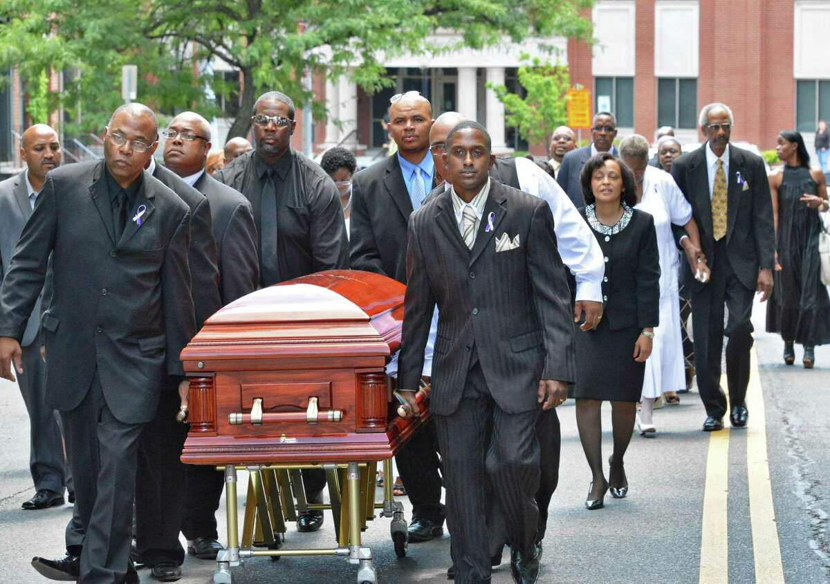 Mourners carry the casket of Pastor Emeritus Willis F. Bruton down Ten Broeck St. in Albany following funeral services at Sweet Pilgrim Missionary Baptist Church Thursday June 28, 2012. (John Carl D'Annibale / Times Union)