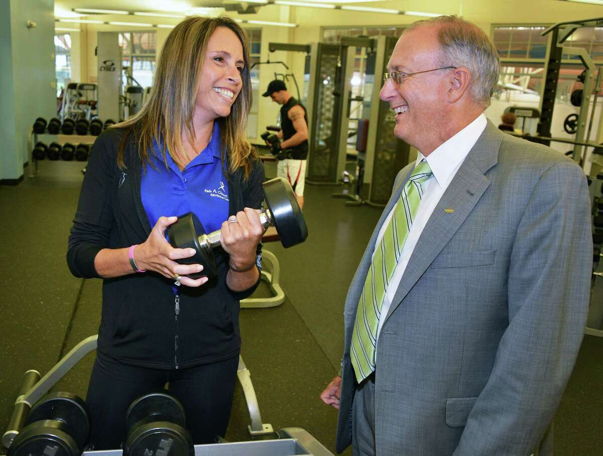 Mary Ibbetson, cancer survivor and founder of The Well on Our Way program at CYC?s Rudy A. Ciccotti Recreation Center in Colonie with Dr. John Bennett, CDPHP president and CEO, in the center's weight room Wednesday June 27, 2012. (John Carl D'Annibale / Times Union)