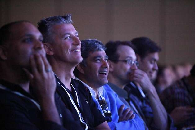 Amit Singh (center), Google vice president enterprise, reacts with others while watching parachutists, who jumped from a blimp, land on the roof at Moscone West at the Google I/O conference on Thursday, June 28, 2012 in San Francisco, Calif. Photo: Lea Suzuki, The Chronicle