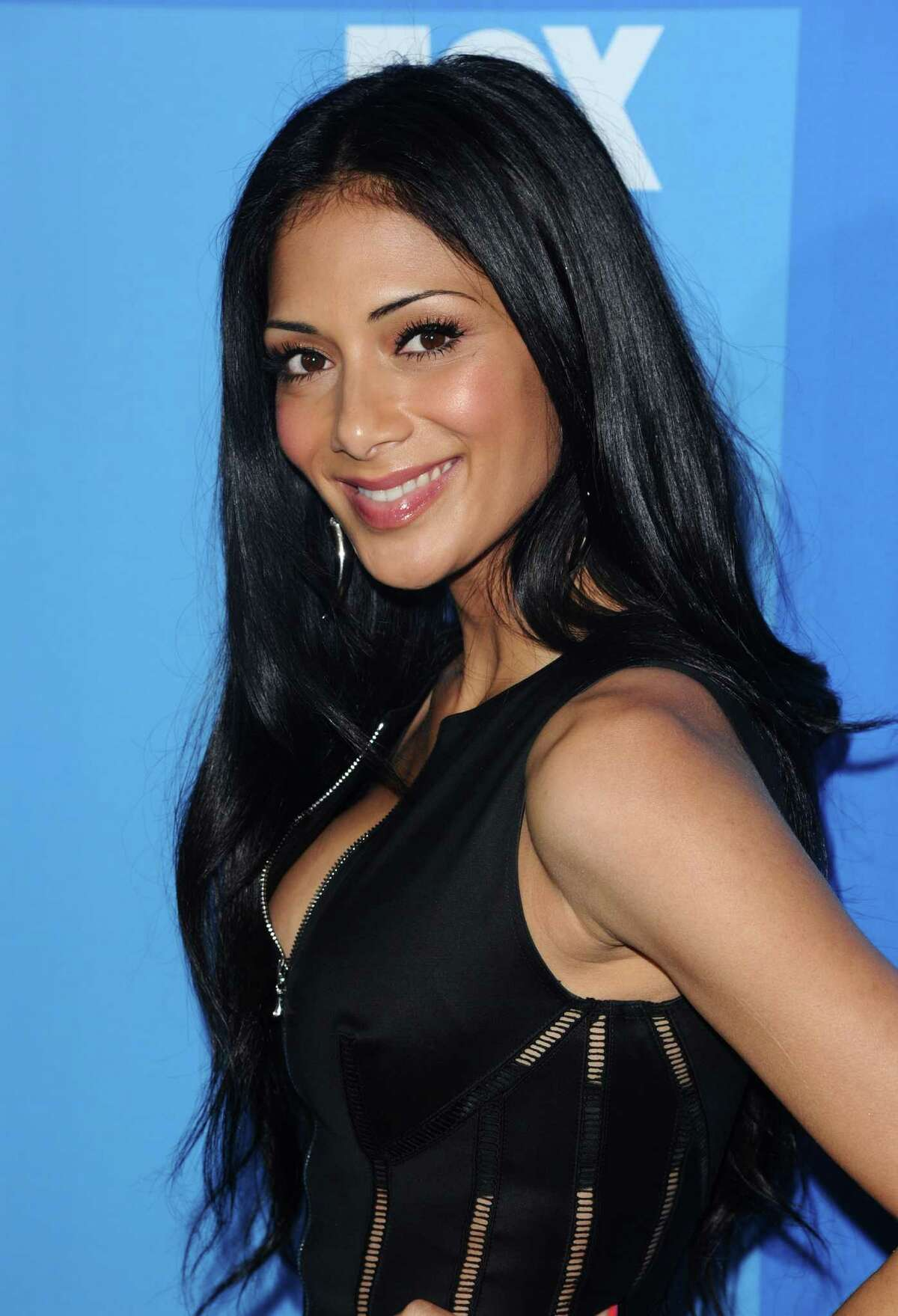 FILE - In this May 16, 2011 file photo, singer Nicole Scherzinger attends the 2011 Fox Upfront party in New York. Fox confirmed Monday, June 6, 2011 that Scherzinger will replace Cheryl Cole as a judge on the talent competition series