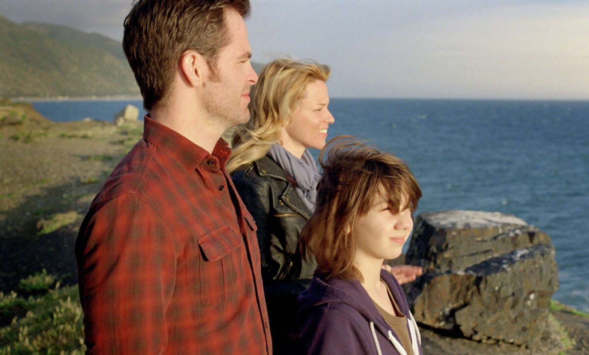 This film image released by Disney/Dreamworks II shows, from left, Chris Pine, Elizabeth Banks and Michael D'Addario in a scene from