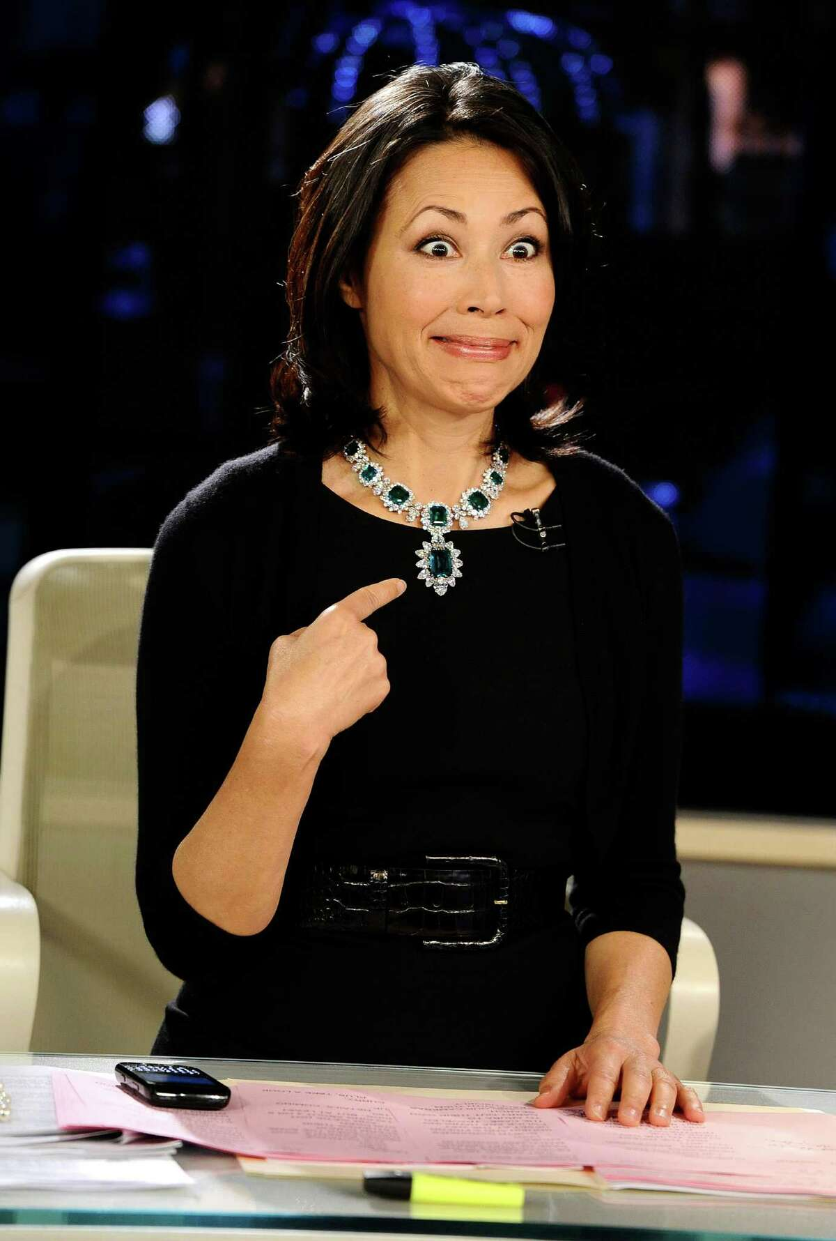 This Sept. 7, 2011 photo released by NBC shows co-host Ann Curry modeling one of Elizabeth Taylor's necklaces, which was auctioned by Christie's, on the
