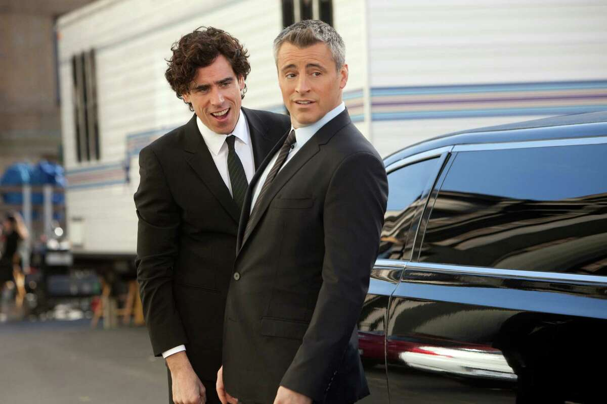 This image released by Showtime shows actors Stephen Mangan as Sean Lincoln, left, and Matt LeBlanc as himself in a scene from the second season of