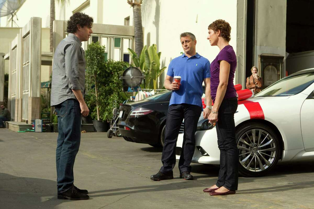 This image released by Showtime shows actors, from left, Stephen Mangan as Sean Lincoln, Matt LeBlanc as himself and Tamsin Greig as Beverly Lincoln in a scene from the second season of