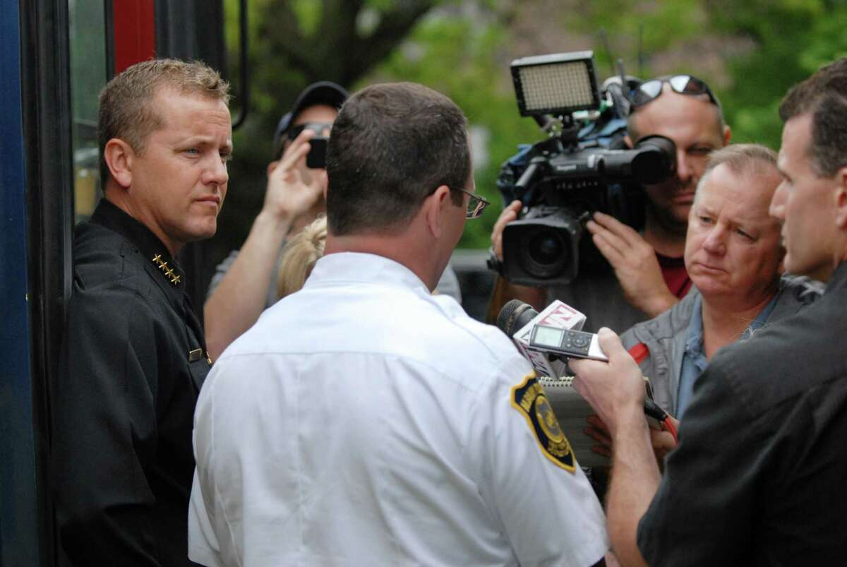 Sheriff Craig Apple, left, and Police Chief Steven Krokoff , right, answered questions Friday May 25, 2012, regarding an internal review of a recent raid on an Albany spa. The comments were made following an unrelated press conference at Albany?s Livingston Park. (Will Waldron /Times Union)
