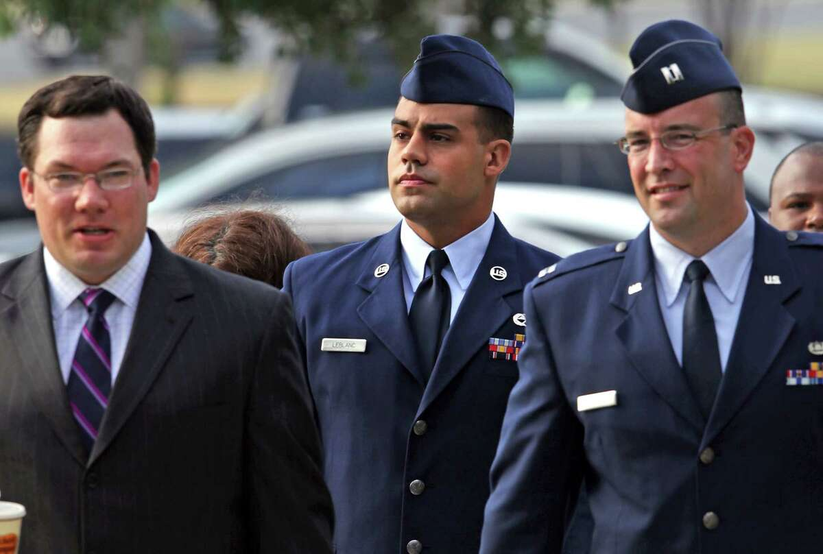 Staff Sgt. Craig LeBlanc, center, walks with his attorneys Capt. Terry Dougherty, right, and Joseph Jordan, left, for an evidentiary hearing involving his part in inappropriate sexual relations with female airmen.Thursday, June 28, 2012.