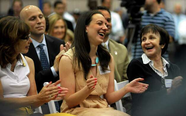 Olympic Champion Figure Skater Sarah Hughes laughs with her mom Amy Hughes, right, and family friend Ellen Halpern, left, at the Chelsea Piers Connecticut ceremonial ribbon cutting. The story of Hughes attending the opening of the New York Chelsea Piers facility as a young girl was shared at the celebration at the Blachley Road campus in Stamford, Conn. on Thursday June 28, 2012. Photo: Cathy Zuraw / Stamford Advocate