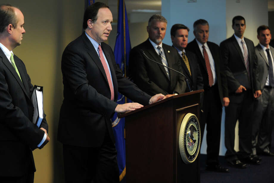 U.S. Attorney David B. Fein speaks at a press conference in Bridgeport, Conn., June 28th, 2012, where he announced that Pratt & Whitney Canada Corp., a Canadian subsidiary of Connecticut based United Technologies Corporation, pleaded guilty to violating the Arms Export Control Act and making false statements in connection with the illegal export to China of military software that lead to the development of ChinaâÄôs first modern military attack helicopter, the Z-10. (Connecticut Post/Ned Gerard) Photo: Ned Gerard / Connecticut Post