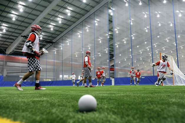 Lacrosse action at the Chelsea Piers Connecticut facility in Stamford, Conn. on Thursday June 28, 2012. A ceremonial ribbon cutting was held at the Blachley Road campus which opens to the public on July 9, 2012. Photo: Cathy Zuraw / Stamford Advocate