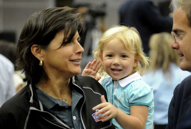 Tennis Hall of Famer Gigi Fernandez holds her daughter Madison Fernandez-Geddes at the Chelsea Piers Connecticut ceremonial ribbon cutting at the Blachley Road campus in Stamford, Conn. on Thursday June 28, 2012. Fernandez is the director of tennis at Chelsea Piers Connecticut. Photo: Cathy Zuraw / Stamford Advocate