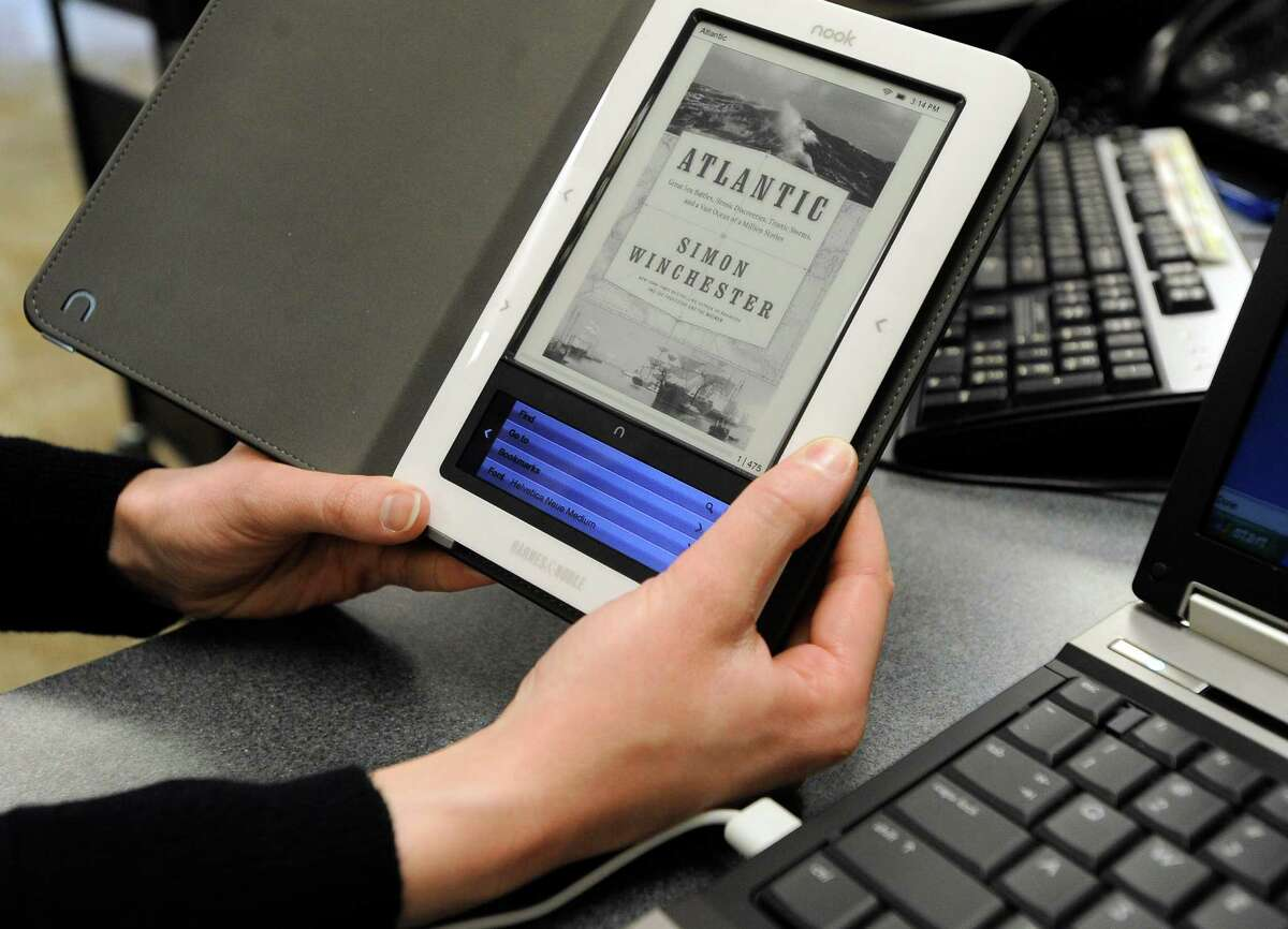 E-book readers have been relatively slow to borrow digital works from the library, frustrated by a limited selection and by not even knowing if their local branch offers e-releases, according to a survey published Friday, June 22, 2012 by the Pew Research Center. (AP Photo/The Argus Leader, Emily Spartz, File)
