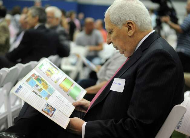 Rick Caro checks out thr brochure for Chelsea Piers Connecticut at the ceremonial ribbon cutting at the Blachley Road campus in Stamford, Conn. on Thursday June 28, 2012. Photo: Cathy Zuraw / Stamford Advocate