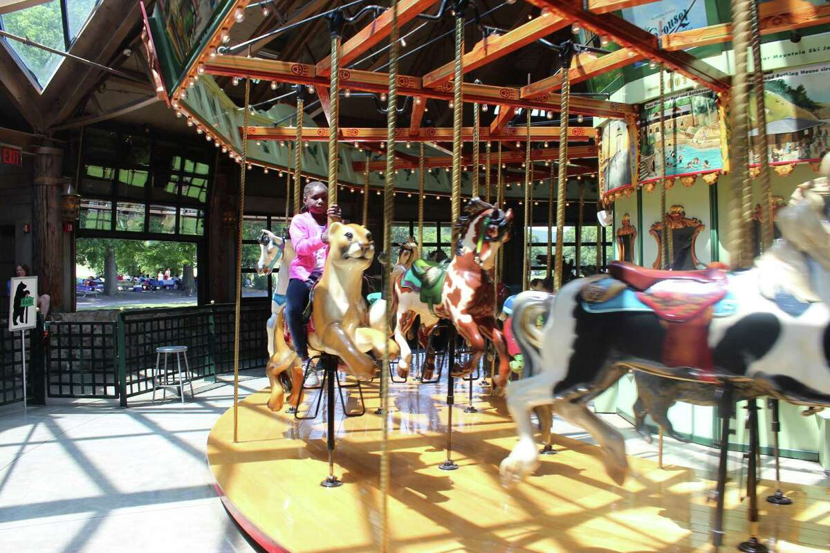 Hit the carousel before hitting the Trailside Museums & Zoo so you can ride on an indigenous animal before viewing them. (By Donna Liquori)