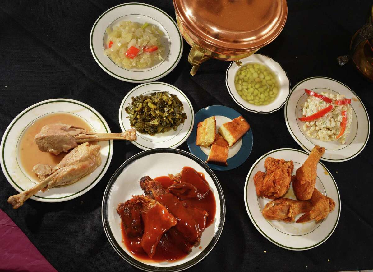 Turkey legs, collard greens, corn bread, smothered cabbage, lima beans, macaroni salad and bar-b-que ribs at the Madame Chef restaurant on North Allen Street in Albany June 26, 2012. (John Carl D'Annibale / Times Union)