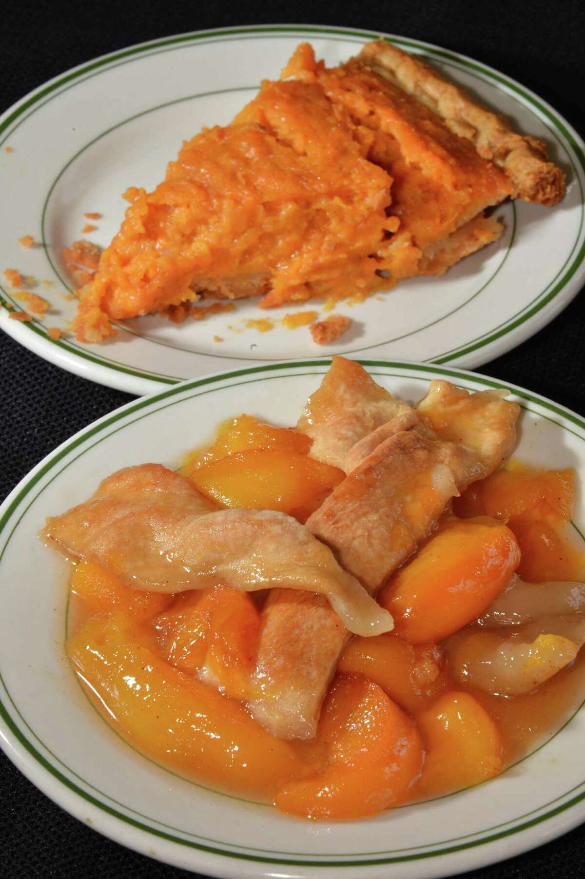 Home made desserts, sweet potato pie, top, and peach cobbler at the Madame Chef restaurant on North Allen Street in Albany June 26, 2012. (John Carl D'Annibale / Times Union)