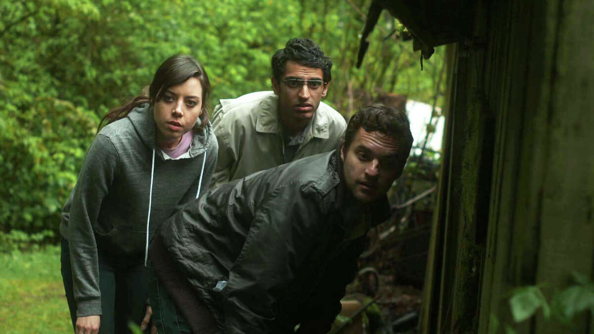 FilmDistrict Aubreay Plaza, left, Karan Soni and Jake Johnson look into a would-be time-traveler in ?Safety Not Guaranteed,? opening Friday.