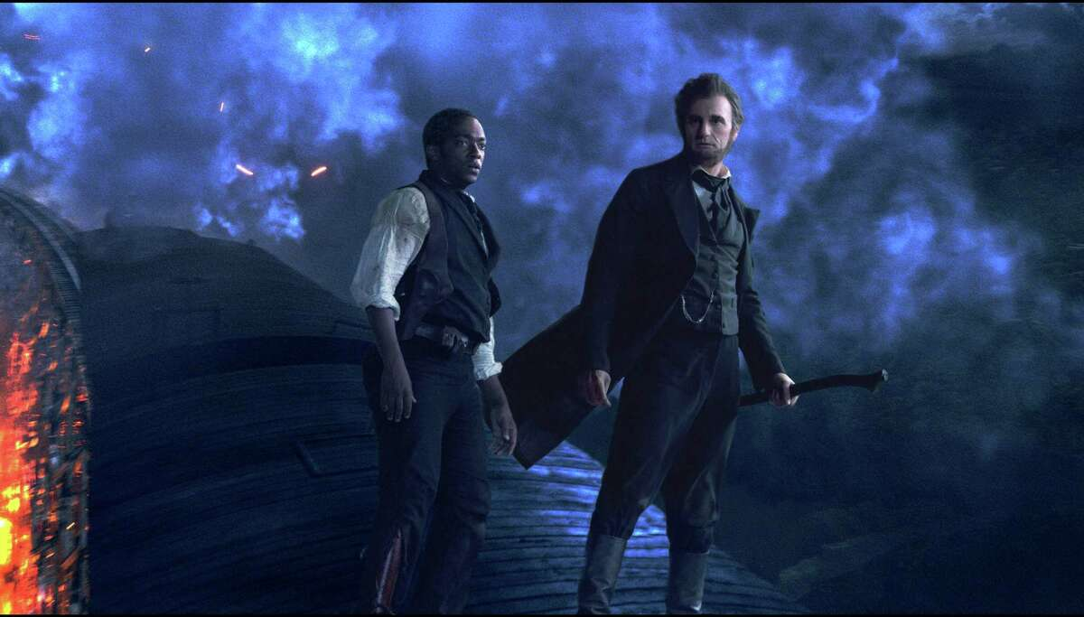 FILE - This publicity file photo released by 20th Century Fox, shows Anthony Mackie portraying Will Johnson, left, and Benjamin Walker portraying Abraham Lincoln in a scene from
