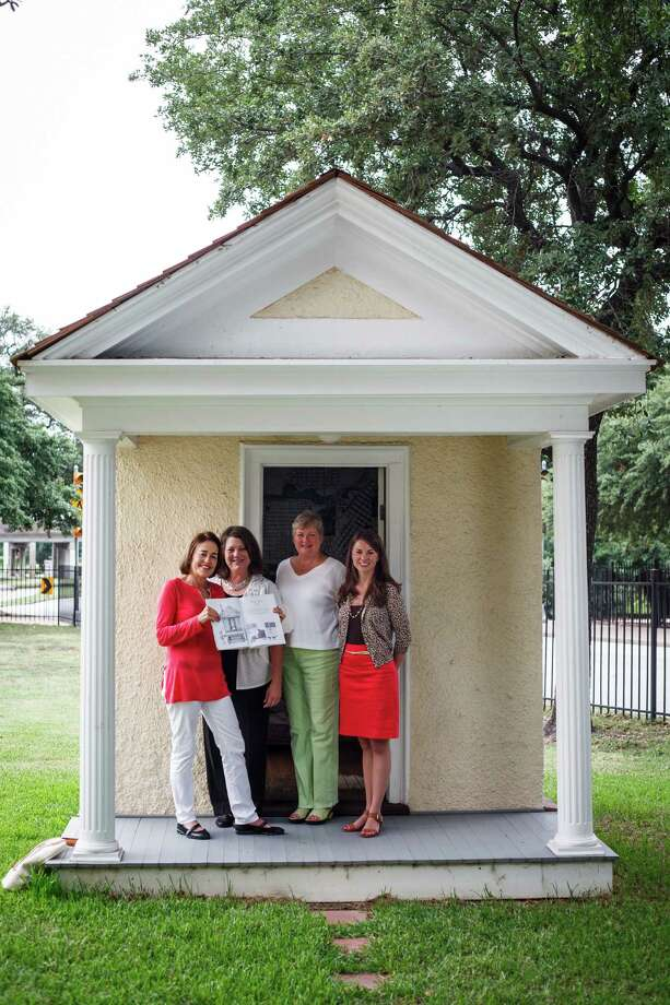 """Andrea White, left, the former first lady of Houston, stands along with employees of the Heritage Society while holding a copy of her recently published picture book for kids: """"The Very Long Life of Alice's Playhouse: A Survivor's Story,"""" in front of the 118-year-old playhouse belonging to Alice Graham Baker, the daughter of Captain James A. Baker, at Sam Houston Park, Monday, June 18, 2012, in Houston.  ( Michael Paulsen / Houston Chronicle ) Photo: Michael Paulsen / © 2012 Houston Chronicle"""
