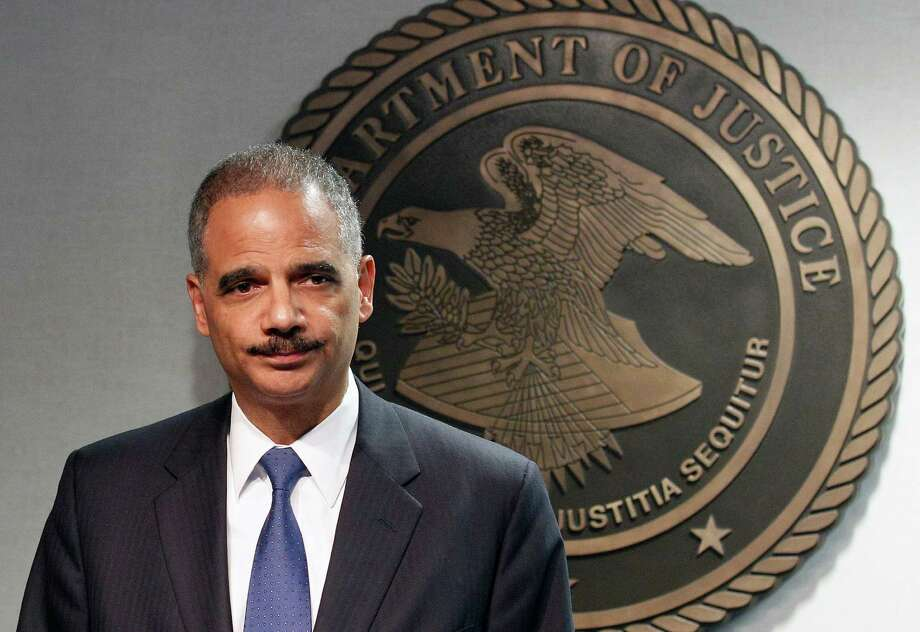 Attoney General Eric Holder speaks during  a news conference in New Orleans, Thursday, June 28, 2012. The Obama administration and House Republicans refused to find a middle ground in a dispute over documents related to a botched gun-tracking operation, and the GOP plunged ahead with plans for precedent-setting votes Thursday to hold Attorney General Eric Holder in civil and criminal contempt o Congress. (AP Photo/Bill Haber) Photo: Bill Haber
