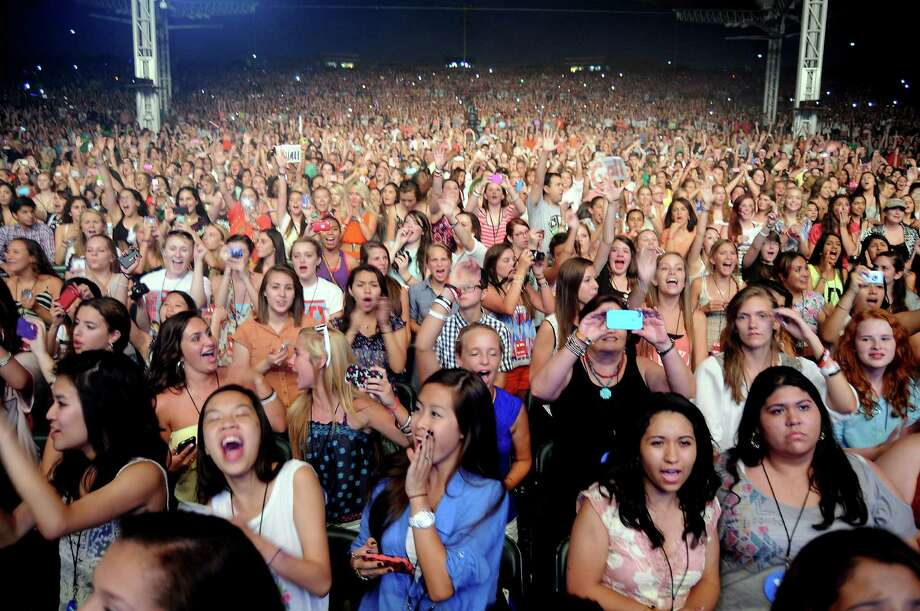 Science can explain why teenage girls go nuts over boy bands, such as at One Direction's sold-out show Sunday at the Cynthia Woods Mitchell Pavilion. Photo: Dave Rossman / © 2012 Dave Rossman
