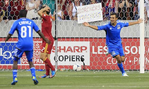 SANDY, UT - JUNE 23:  Chris Wondolowski #8 of the San Jose Earthquakes celebrates his game winning goal with his teammate Marvin Chavez #81 as Tony Beltran #2 of Real Salt Lake reacts during the second half of an MLS soccer game June 23, 2012 at Rio Tinto Stadium in Sandy, Utah. Beat Real Salt Lake 2-1. (Photo by George Frey/Getty Images) Photo: George Frey, Getty Images