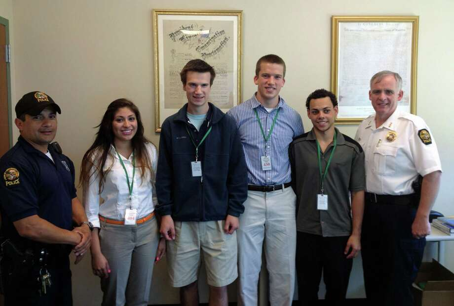 From left, Student Resource Officer Carlos Franco, Greenwich Police Department interns Michelle Ospina, Endy Anderson, John Pendergast and Igor Teixeira, and Chief James Heavey at police headquarters recently. Photo courtesy of Greenwich Police. Photo: Contributed Photo / Greenwich Time Contributed