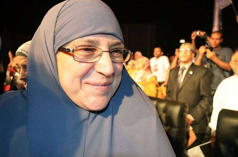 In this Saturday, May 12, 2012 photo, the wife of then Presidential candidate Mohammed Morsi, Naglaa Ali Mahmoud, attends a rally during his campaign in Cairo, Egypt. Egypt's new first lady Naglaa Ali Mahmoud and her predecessor Suzanne Mubarak have at least one thing in common: Both have seen their husbands and sons detained in Egyptian prisons. The similarities may end there though. Suzanne Mubarak was often criticized as being vain, self-important and strong-willed _ propelling her son, Gamal, toward inheriting the presidency. But the wife of Islamist President-elect Mohammed Morsi is a conservative, religious Muslim who wears the veil and appears to be extremely modest. (AP Photo/Ahmad Hammad) Photo: Ahmad Hammad, Associated Press
