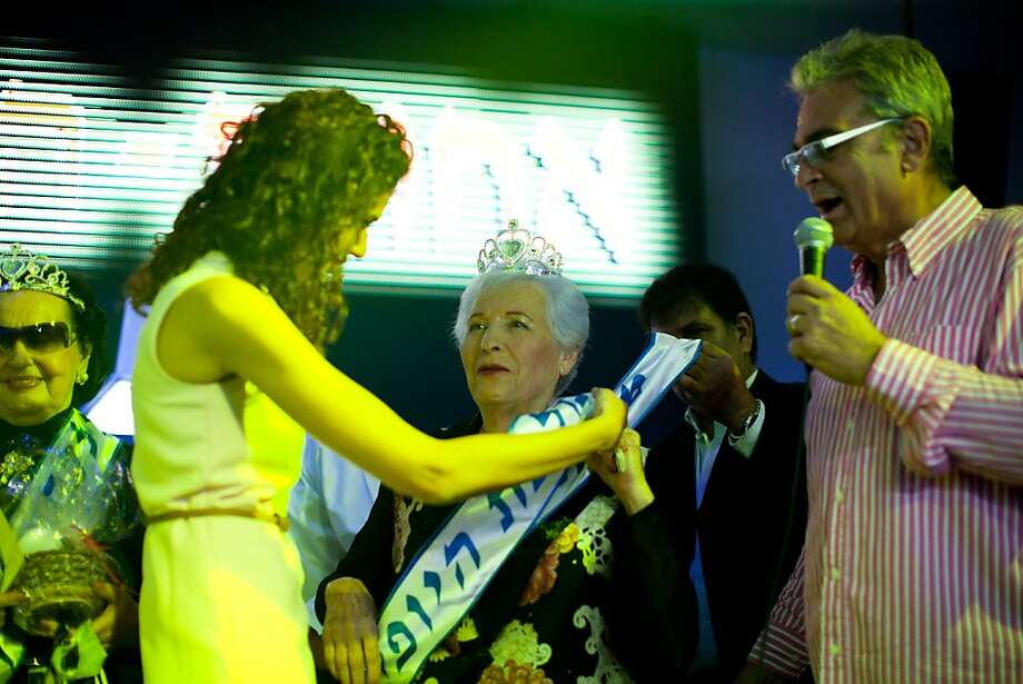 HAIFA, ISRAEL - JUNE 28:  (ISRAEL OUT) Israeli Holocaust survivor and winner of the Holocaust survivors beauty pageant, Chava Hershkovitz, 78, is awarded during the beauty pageant, on June 28, 2012 in Haifa, Israel. During the pageant, the twenty women competing, between 74 to 90 years of age, shared Holocaust stories witht he audience. (Photo by Uriel Sinai/Getty Images) Photo: Uriel Sinai, Getty Images