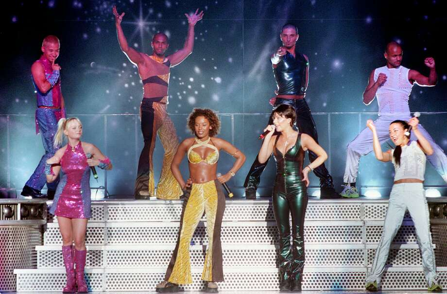 "The Spice Girls, in this June 25, 1998 photo in Holmdel Township, N.J., Baby Spice, Scarey Spice, Posh Spice and Sporty Spice, from left, proved there is ""life after Ginger'' when their single ""Viva Forever"" went straight to No. 1 in the British pop charts. It was the seventh chart-topper for the feisty group with the Girl Power mantra, but the first since Ginger Spice, Geri Halliwell, quit. Photo: DARYL STONE, Associated Press / ASBURY PARK PRESS"
