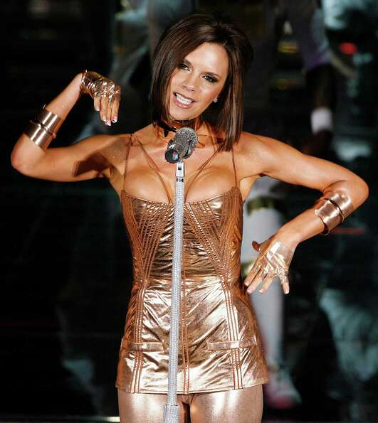 Victoria Beckham performs on stage with The Spice Girls at the Madrid Arena during the Spanish leg o