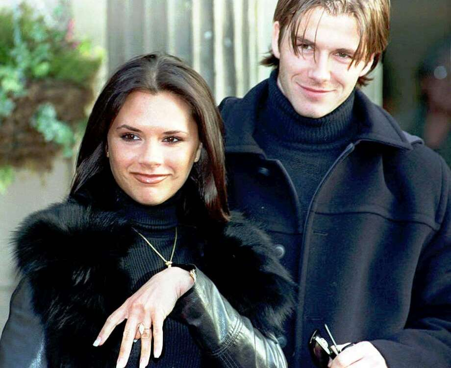 Victoria ''Posh Spice'' Adams of Spice Girls fame displays her engagement ring as she and British soccer star fiance David Beckham leave a hotel near Chester, England, on Jan. 25, 1998. The two were married in July 1999. Photo: JOHN GILES, Associated Press / PA