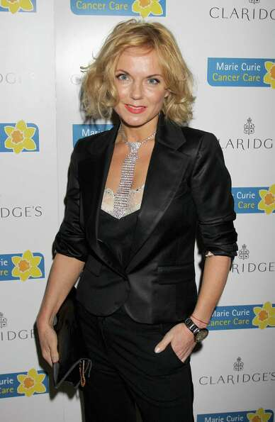 Geri Halliwell poses at the Marie Curie Cancer Care Fundraiser at Claridge's Hotel in London on May