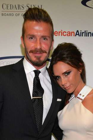 Professional soccer player David Beckham and wife Victoria Beckham arrive at the 27th Anniversary Sports Spectacular benefiting Cedars-Sinai Medical Genetics Institute at the Hyatt Regency Century Plaza  in Century City, Calif., on May 20, 2012. Photo: Alberto E. Rodriguez, Getty Images For Sports Spectacu / 2012 Getty Images