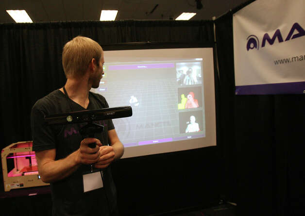 Nicolas Burrus, co-founder of Manctl, demonstrates his company's 3D-scanning program on a reporter/photographer at the Microsoft Accelerator for Kinect exhibition in Redmond on Thursday, June 28, 2012. Their customers so far are companies that make shoe orthotics and bras. Photo: Aubrey Cohen/seattlepi.com Staff